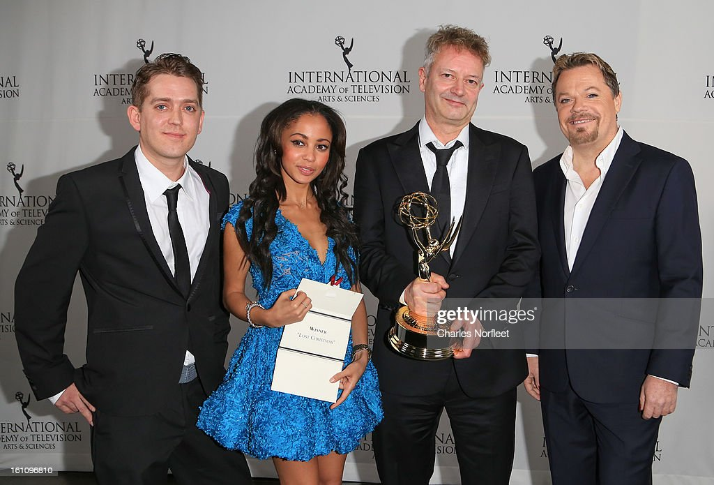 Producer Elliot Jenkins, actress/presenter Vanessa Morgan, director John Hay, and principal cast member Eddie Izzard with the Kids; TV Movie/Mini-Series Emmy Award for 'Lost Christmas' attend The Inaugural International Emmy Kids Awards at The Lighthouse at Chelsea Piers on February 8, 2013 in New York City.