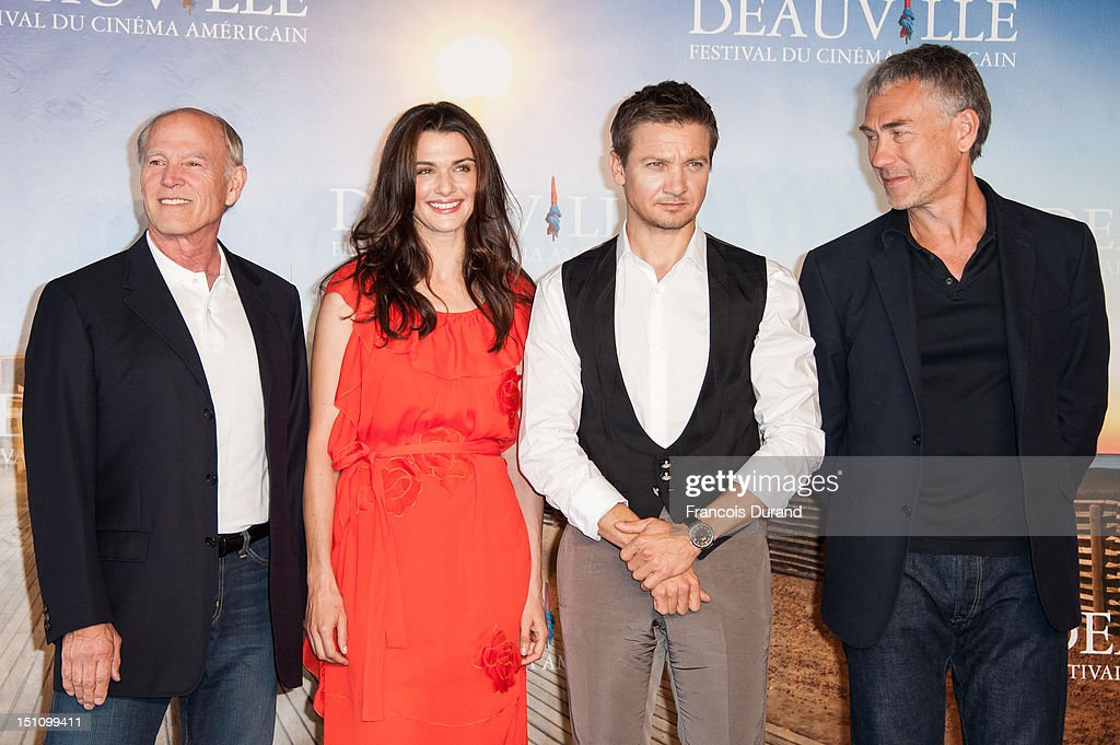 US producer <a gi-track='captionPersonalityLinkClicked' href=/galleries/search?phrase=Frank+Marshall&family=editorial&specificpeople=234750 ng-click='$event.stopPropagation()'>Frank Marshall</a>, British actress <a gi-track='captionPersonalityLinkClicked' href=/galleries/search?phrase=Rachel+Weisz&family=editorial&specificpeople=204656 ng-click='$event.stopPropagation()'>Rachel Weisz</a>, US actor <a gi-track='captionPersonalityLinkClicked' href=/galleries/search?phrase=Jeremy+Renner&family=editorial&specificpeople=708701 ng-click='$event.stopPropagation()'>Jeremy Renner</a> and US director <a gi-track='captionPersonalityLinkClicked' href=/galleries/search?phrase=Tony+Gilroy&family=editorial&specificpeople=655777 ng-click='$event.stopPropagation()'>Tony Gilroy</a> pose at 'The Bourne Legacy' Photocall during 38th Deauville American Film Festival on September 1, 2012 in Deauville, France.