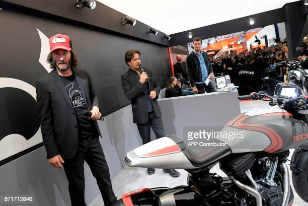 US producer Gard Hollinger speaks next to Canadian actor Keanu Reeves during the presentation of the new motorbike Arch 1s during the 2017 Milano...