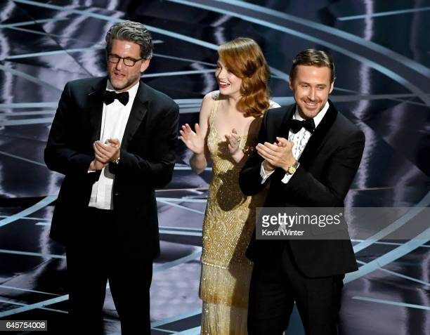 Producer Gary Gilbert actors Emma Stone and Ryan Gosling celebrate 'La La Land' winning Best Picture due to a presentation error onstage during the...