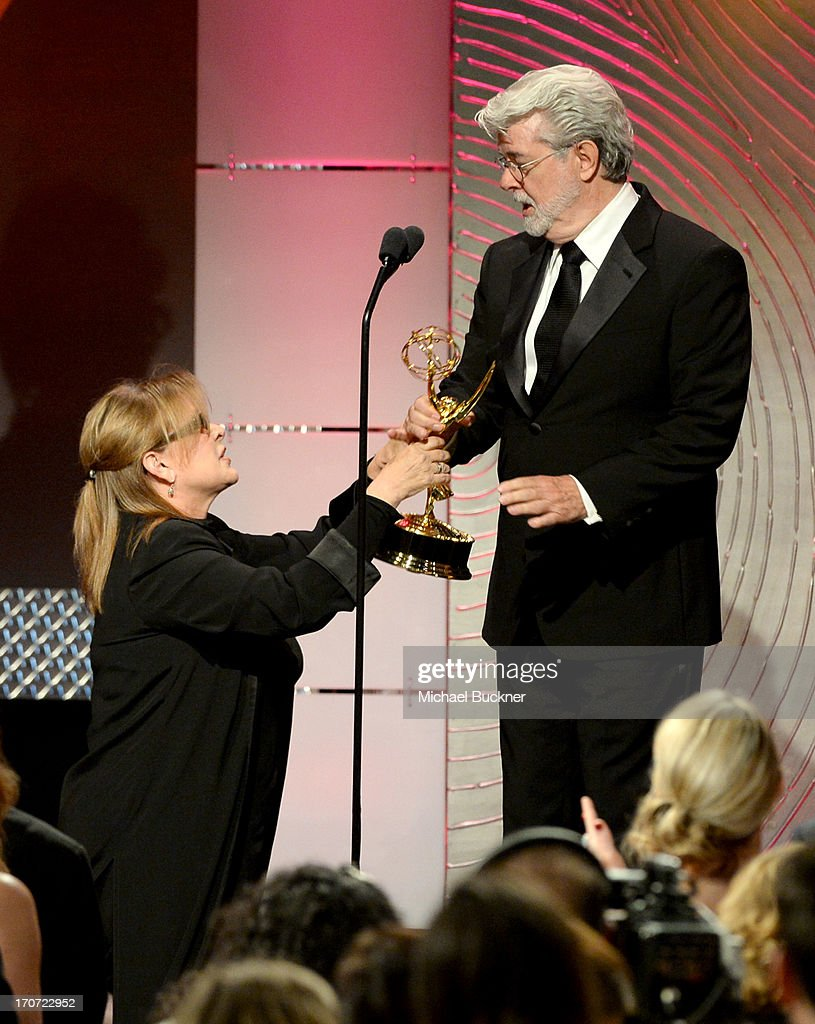 Producer <a gi-track='captionPersonalityLinkClicked' href=/galleries/search?phrase=George+Lucas&family=editorial&specificpeople=202500 ng-click='$event.stopPropagation()'>George Lucas</a> (R) accepts the Outstanding Special Class Animated Program award for 'Star Wars: The Clone Wars' from presenter <a gi-track='captionPersonalityLinkClicked' href=/galleries/search?phrase=Carrie+Fisher&family=editorial&specificpeople=209183 ng-click='$event.stopPropagation()'>Carrie Fisher</a> onstage during the 40th Annual Daytime Emmy Awards at the Beverly Hilton Hotel on June 16, 2013 in Beverly Hills, California. 23774_001_2291.JPG