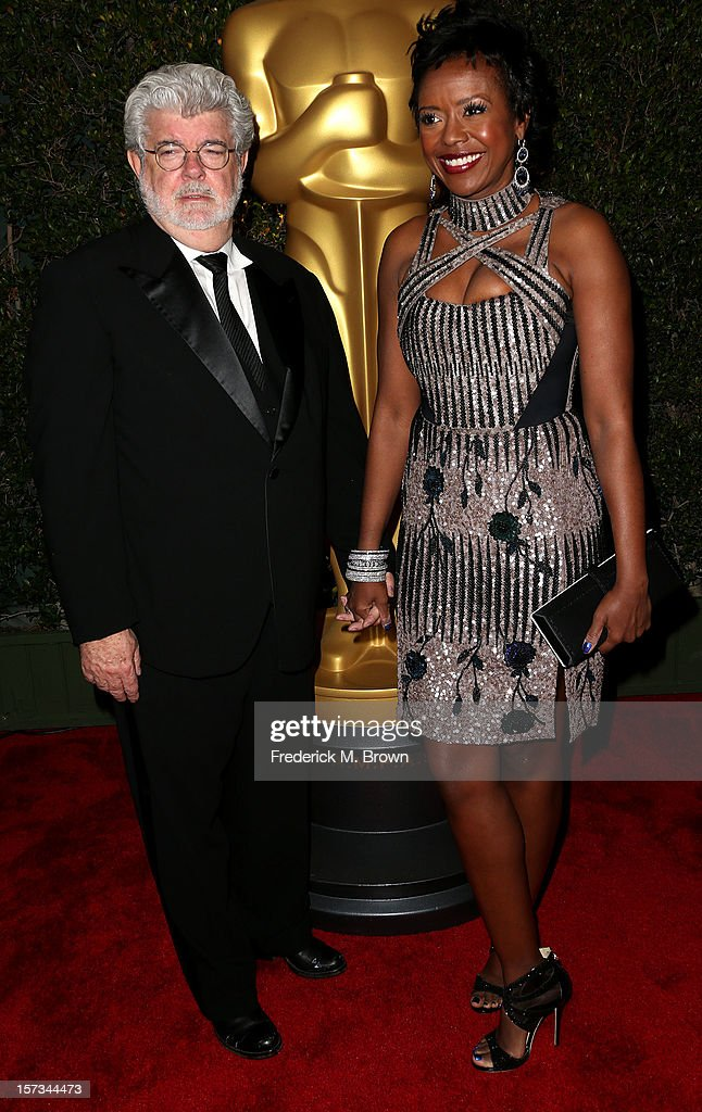 Producer George Lucas (L) and his wife Mellody Hobson attend the Academy Of Motion Picture Arts And Sciences' 4th Annual Governors Awards at Hollywood and Highland on December 1, 2012 in Hollywood, California.