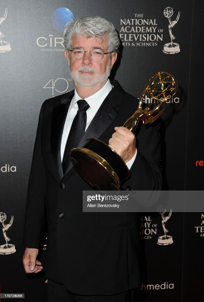 Producer <a gi-track='captionPersonalityLinkClicked' href=/galleries/search?phrase=George+Lucas&family=editorial&specificpeople=202500 ng-click='$event.stopPropagation()'>George Lucas</a> poses with the Outstanding Special Class Animated Program award for 'Star Wars: The Clone Wars' at 40th Annual Daytime Entertaimment Emmy Awards at The Beverly Hilton Hotel on June 16, 2013 in Beverly Hills, California.