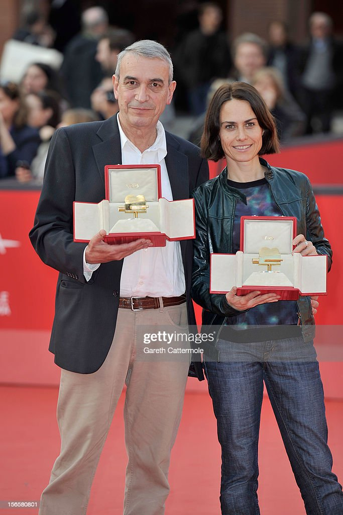 Producer Gianfilippo Pedote poses with the Tao Due Camera d'Oro 2012 Best Producer Award for the movie 'Tutti Parla di Te' and <a gi-track='captionPersonalityLinkClicked' href=/galleries/search?phrase=Claudia+Pandolfi&family=editorial&specificpeople=2082927 ng-click='$event.stopPropagation()'>Claudia Pandolfi</a> poses with the Lancia 2012 Elegance In Motion Award as they attend the Collateral Awards Red Carpet photocall during the 7th Rome Film Festival at Auditorium Parco Della Musica on November 17, 2012 in Rome, Italy.