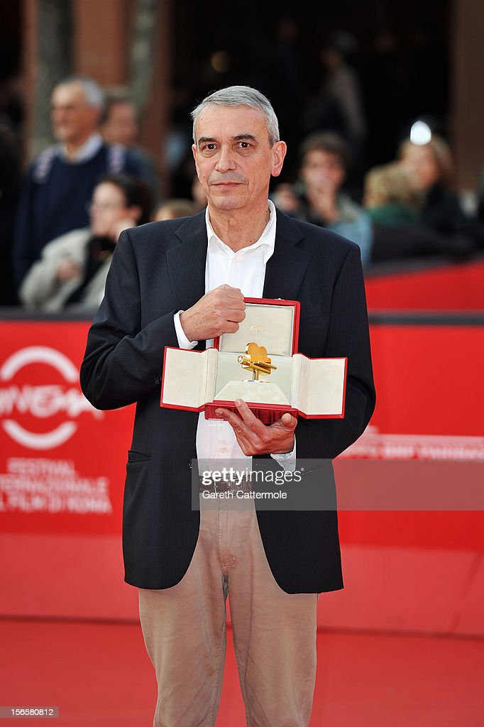 Producer Gianfilippo Pedote poses with the Tao Due Camera d'Oro 2012 Best Producer Award for the movie 'Tutti Parla di Te' as he attends the Collateral Awards Red Carpet photocall during the 7th Rome Film Festival at Auditorium Parco Della Musica on November 17, 2012 in Rome, Italy.