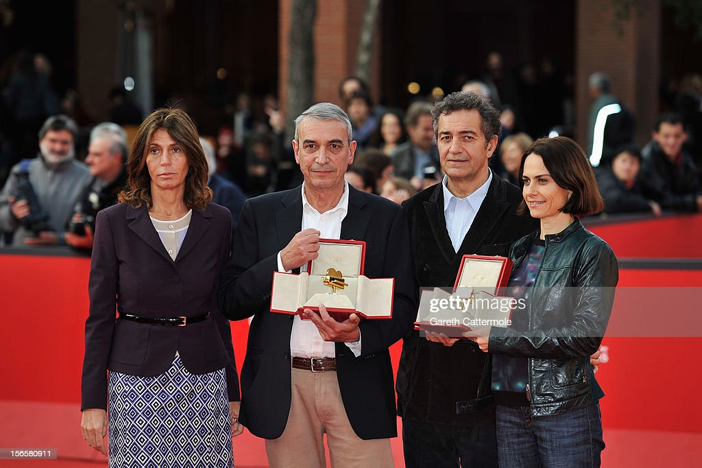 Producer Gianfilippo Pedote (2L) poses with the Tao Due Camera d'Oro 2012 Best Producer Award for the movie 'Tutti Parla di Te' and <a gi-track='captionPersonalityLinkClicked' href=/galleries/search?phrase=Claudia+Pandolfi&family=editorial&specificpeople=2082927 ng-click='$event.stopPropagation()'>Claudia Pandolfi</a> (R) poses with the Lancia 2012 Elegance In Motion Award as they attend the Collateral Awards Red Carpet photocall during the 7th Rome Film Festival at Auditorium Parco Della Musica on November 17, 2012 in Rome, Italy.
