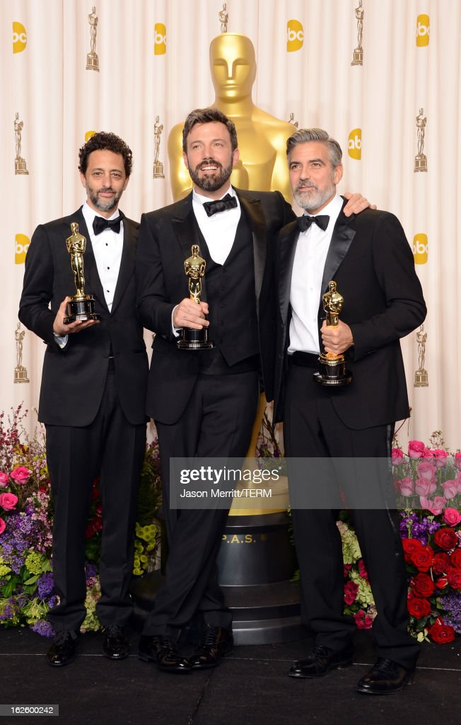 Producer Grant Heslov actorproducerdirector Ben Affleck and producer George Clooney winners of the Best Picture award for 'Argo' pose in the press...