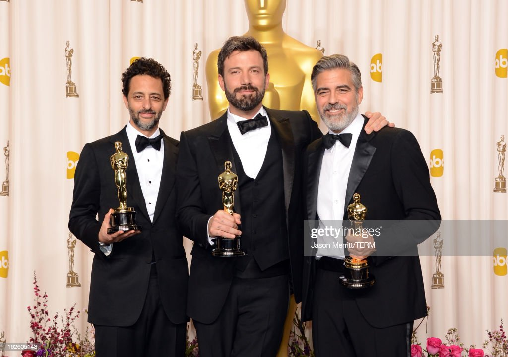 Producer Grant Heslov, actor-producer-director Ben Affleck, and producer George Clooney, winners of the Best Picture award for 'Argo,' pose in the press room during the Oscars held at Loews Hollywood Hotel on February 24, 2013 in Hollywood, California.