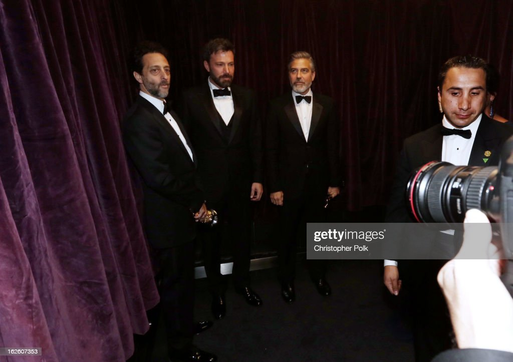 Producer Grant Heslov actorproducerdirector Ben Affleck and producer George Clooney winners of the Best Picture award for 'Argo' backstage during the...