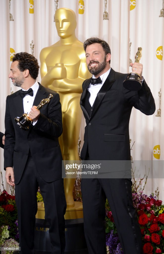 Producer Grant Heslov and actorproducerdirector Ben Affleck winners of the Best Picture award for 'Argo' pose in the press room during the Oscars...