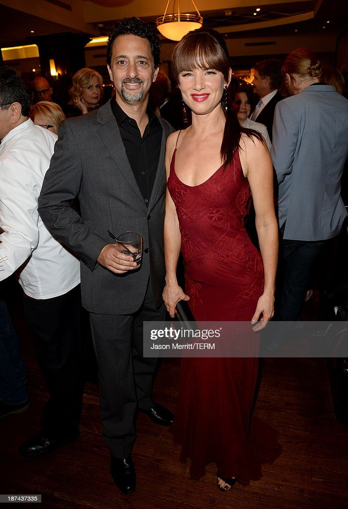Producer <a gi-track='captionPersonalityLinkClicked' href=/galleries/search?phrase=Grant+Heslov&family=editorial&specificpeople=607201 ng-click='$event.stopPropagation()'>Grant Heslov</a> (L) and actress <a gi-track='captionPersonalityLinkClicked' href=/galleries/search?phrase=Juliette+Lewis&family=editorial&specificpeople=202873 ng-click='$event.stopPropagation()'>Juliette Lewis</a> attend The Weinstein Company Presents 'August: Osage County' Gala Screening Cocktail Reception during AFI FEST 2013 presented by Audi at TCL Chinese Theatre on November 8, 2013 in Hollywood, California.