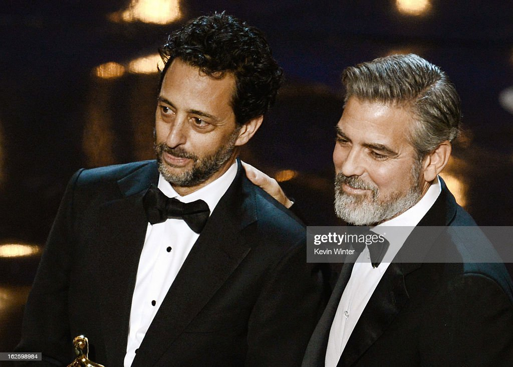 "Producer Grant Heslov and producer George Clooney accept the Best Picture award for ""Argo"" along with members of the cast and crew onstage during the..."