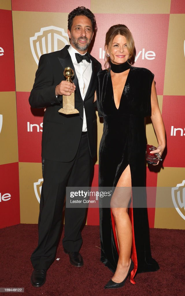 Producer Grant Heslov and wife Lisa Heslov attend the 2013 InStyle and Warner Bros 70th Annual Golden Globe Awards PostParty held at the Oasis...