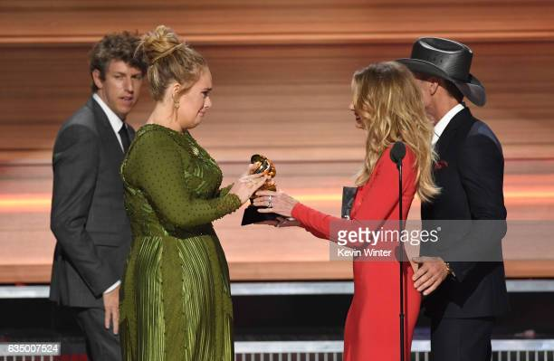 Producer Greg Kurstin and recording artist Adele accept the Album Of The Year award for '25' from recording artists Faith Hill and Tim McGraw onstage...