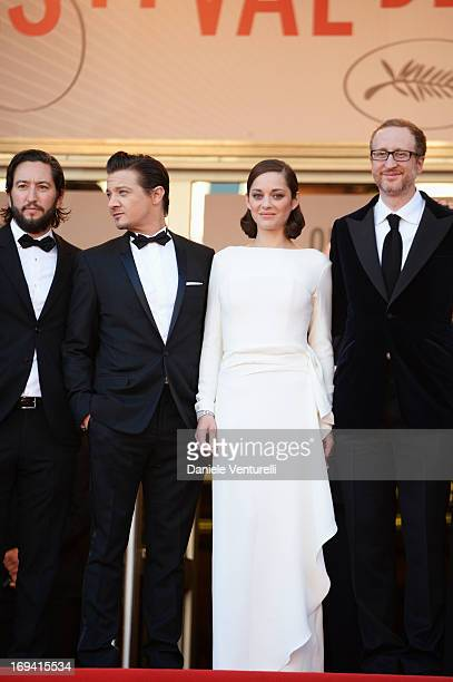 Producer Greg Shapiro actor Jeremy Renner actress Marion Cotillard and director James Gray attend the Premiere of 'The Immigrant' at The 66th Annual...