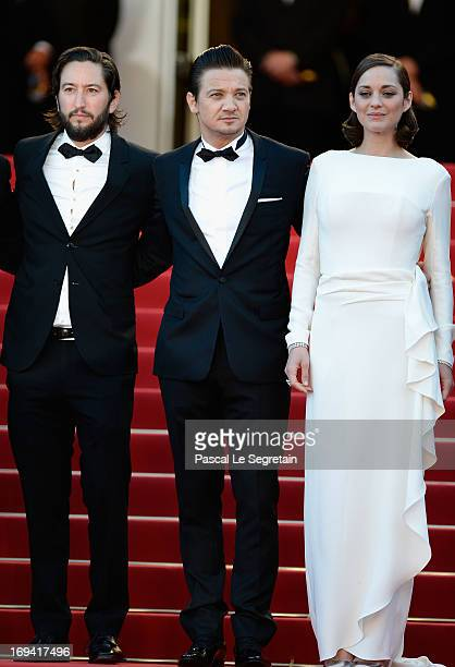 Producer Greg Shapiro actors Marion Cotillard and Jeremy Renner attend the 'The Immigrant' premiere during The 66th Annual Cannes Film Festival at...