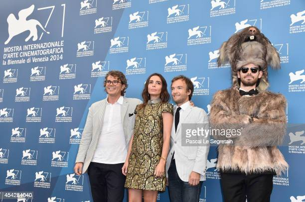 Producer Gregory Bernard actors Elodie Bouchez Jonathan Lambert and a member of the crew dressed as a rat attend the 'Reality' Photocall during the...