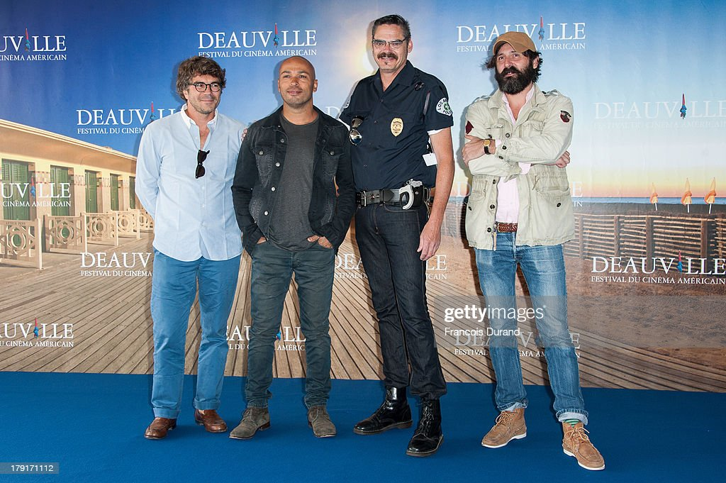 Producer Gregory Bernard, actors Mark Burnham, Eric Judor and director Quentin Dupieux pose during a photocall for the film 'Wrong Cops' during the 39th Deauville American film festival on September 1, 2013 in Deauville, France.