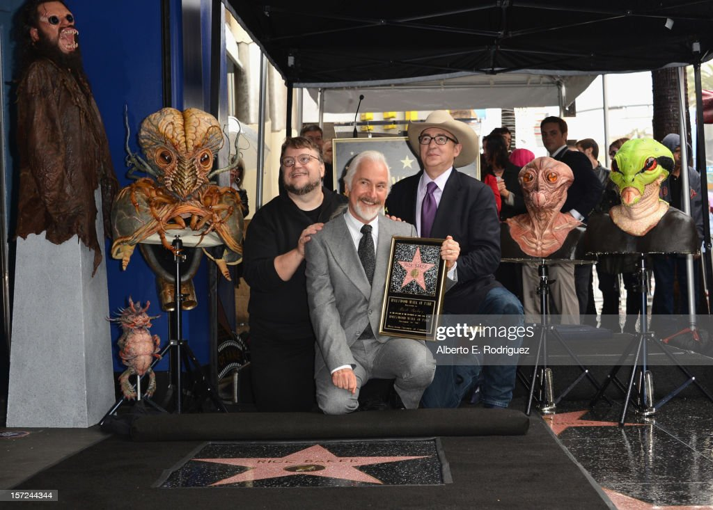 Producer <a gi-track='captionPersonalityLinkClicked' href=/galleries/search?phrase=Guillermo+del+Toro&family=editorial&specificpeople=609181 ng-click='$event.stopPropagation()'>Guillermo del Toro</a>, make-up artist <a gi-track='captionPersonalityLinkClicked' href=/galleries/search?phrase=Rick+Baker&family=editorial&specificpeople=540260 ng-click='$event.stopPropagation()'>Rick Baker</a> and director <a gi-track='captionPersonalityLinkClicked' href=/galleries/search?phrase=Barry+Sonnenfeld&family=editorial&specificpeople=673537 ng-click='$event.stopPropagation()'>Barry Sonnenfeld</a> attend a ceremony honoring <a gi-track='captionPersonalityLinkClicked' href=/galleries/search?phrase=Rick+Baker&family=editorial&specificpeople=540260 ng-click='$event.stopPropagation()'>Rick Baker</a> with the 2,485th star on the Hollywood Walk of Fame on November 30, 2012 in Hollywood, California.