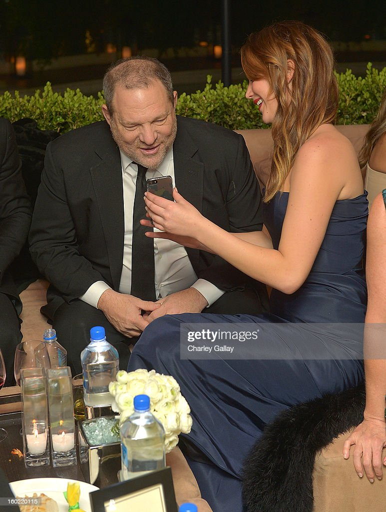 Producer <a gi-track='captionPersonalityLinkClicked' href=/galleries/search?phrase=Harvey+Weinstein&family=editorial&specificpeople=201749 ng-click='$event.stopPropagation()'>Harvey Weinstein</a> (L) and actress <a gi-track='captionPersonalityLinkClicked' href=/galleries/search?phrase=Jennifer+Lawrence&family=editorial&specificpeople=1596040 ng-click='$event.stopPropagation()'>Jennifer Lawrence</a> attend The Weinstein Company's SAG Awards After Party Presented By FIJI Water at Sunset Tower on January 27, 2013 in West Hollywood, California.