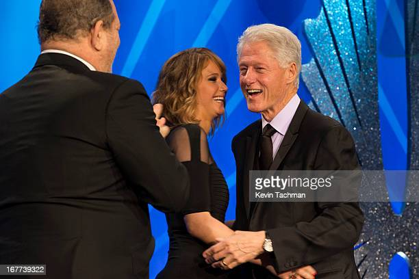 Producer Harvey Weinstein and actress Jennifer Lawrence presents Former President of the United States Bill Clinton with the Advocate for Change...