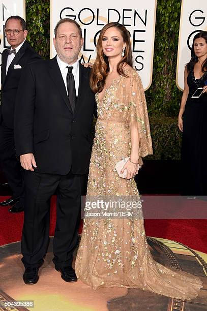 Producer Harvey Weinstein and designer Georgina Chapman attend the 73rd Annual Golden Globe Awards held at the Beverly Hilton Hotel on January 10...
