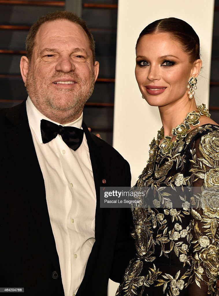 Producer Harvey Weinstein (L) and fashion designer Georgina Chapman attend the 2015 Vanity Fair Oscar Party hosted by Graydon Carter at Wallis Annenberg Center for the Performing Arts on February 22, 2015 in Beverly Hills, California.