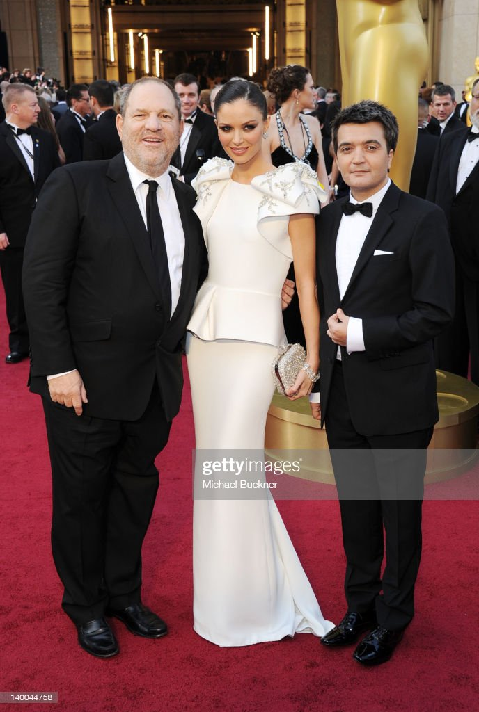 Producer Harvey Weinstein designer Georgina Chapman and producer Thomas Langmann arrive at the 84th Annual Academy Awards held at the Hollywood...