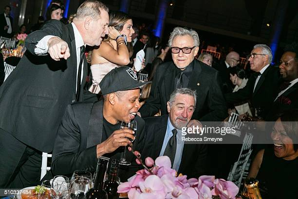 Producer Harvey Weinstein rapper Jay Z actor Harvey Keitel and actor Robert De Niro attend the amFAR New York Gala at Cipriani Wall Street in New...