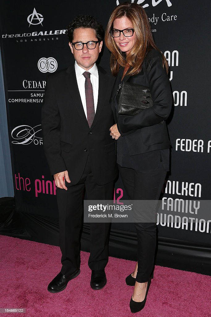 Producer J. J. Abrams (L) and his guest attends Elyse Walker Presents The Eighth Annual Pink Party Hosted By Michelle Pfeiffer To Benefit Cedars-Sinai Women's Cancer Program at Barkar Hangar Santa Monica Airport on October 27, 2012 in Santa Monica, California.