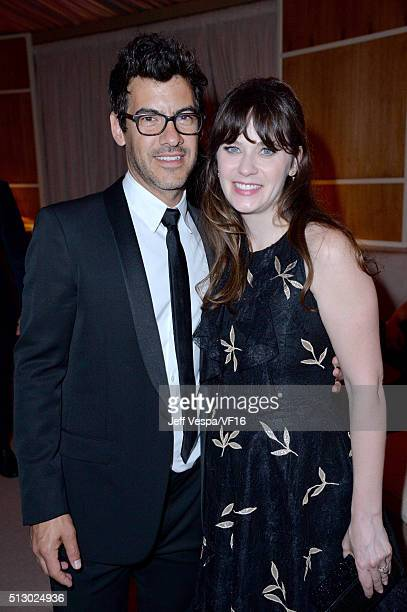 Producer Jacob Pechenik and actress Zooey Deschanel attend the 2016 Vanity Fair Oscar Party Hosted By Graydon Carter at the Wallis Annenberg Center...