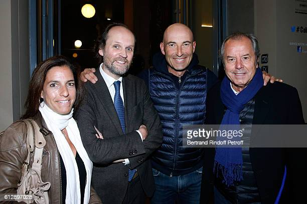 Producer JeanMarc Dumontet Nicolas Canteloup musician Christian Morin and his wife attend the Coluche Exhibition Opening This exhibition is organized...