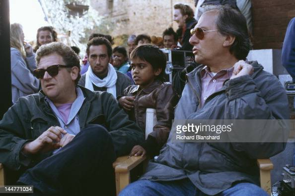 Producer Jeremy Thomas and cinematographer Vittorio Storaro on the set of the film 'Little Buddha' circa 1992 Between them is child actor Raju Lal...