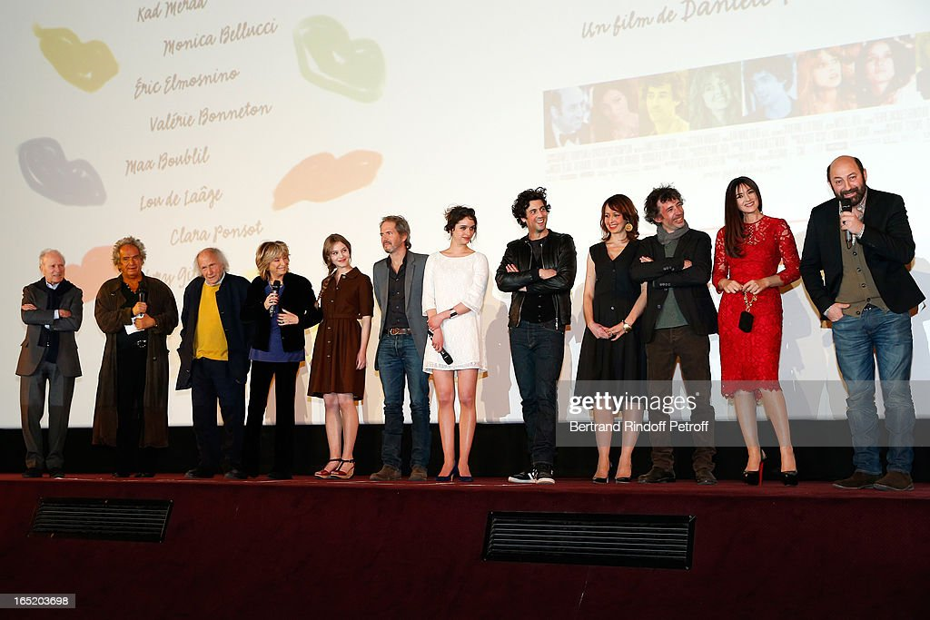 Producer Jerome Seydoux (Pdt Pathe), Producer Albert Koski, Musician Ivry Gitlis, Director Daniele Thompson, Actress Lou de Laage, Christopher Thompson, Actress Clara Ponso, Max Boubli, Actress Valerie Bonneton, Actor Eric Elmosnino, Actress Monica Bellucci and Actor Kad Merad attend 'Des gens qui s'embrassent' movie premiere at Cinema Gaumont Marignan on April 1, 2013 in Paris, France.