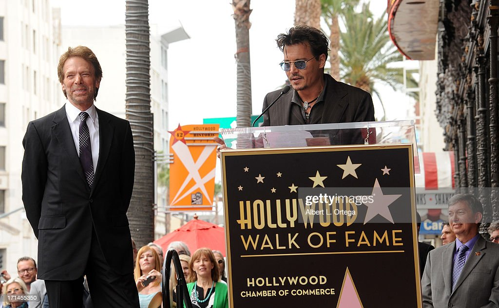 Producer Jerry Bruckheimer and Actor Johnny Depp attend the Jerry Bruckheimer Star On The Hollywood Walk Of Fame on June 24, 2013 in Hollywood, California.