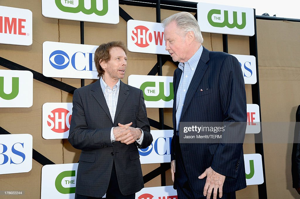 Producer Jerry Bruckheimer and actor Jon Voight arrive at the CW, CBS and Showtime 2013 summer TCA party on July 29, 2013 in Los Angeles, California.