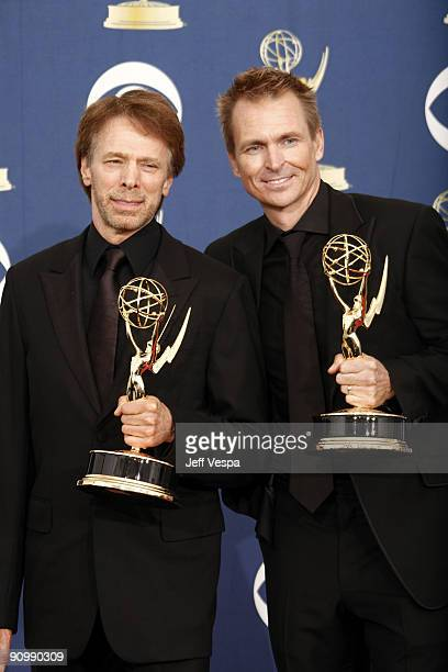 Producer Jerry Bruckheimer and Phil Keoghan pose in the press room at the 61st Primetime Emmy Awards held at the Nokia Theatre on September 20 2009...