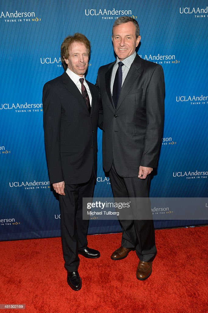 Producer <a gi-track='captionPersonalityLinkClicked' href=/galleries/search?phrase=Jerry+Bruckheimer&family=editorial&specificpeople=203316 ng-click='$event.stopPropagation()'>Jerry Bruckheimer</a> and Walt Disney Company Chairman <a gi-track='captionPersonalityLinkClicked' href=/galleries/search?phrase=Bob+Iger&family=editorial&specificpeople=171211 ng-click='$event.stopPropagation()'>Bob Iger</a> attend the 2013 Joh Wooden Global Leadership Awards hosted by the UCLA Anderson School of Management at The Beverly Hilton Hotel on November 21, 2013 in Beverly Hills, California.