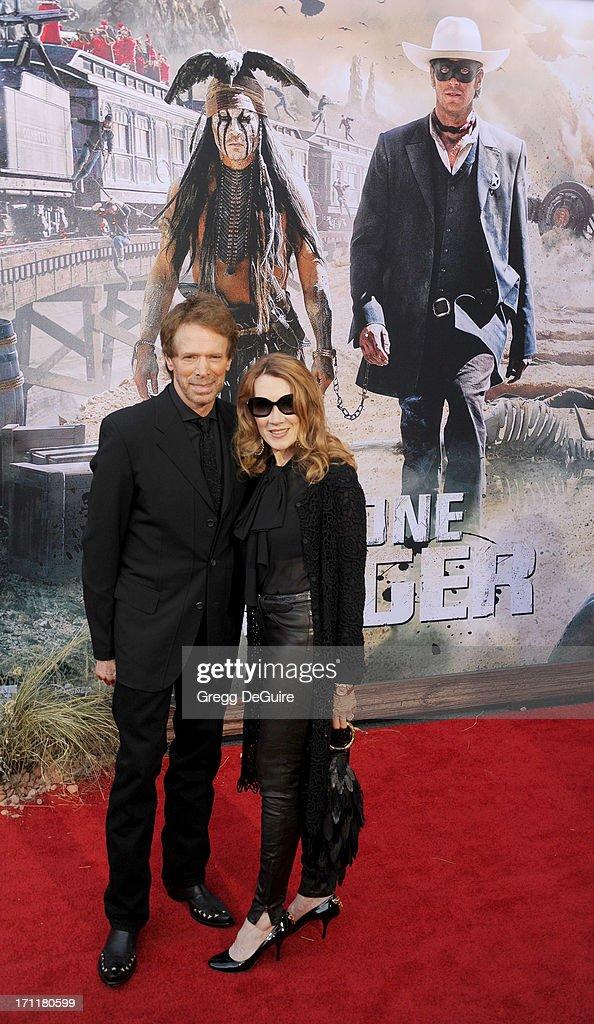Producer Jerry Bruckheimer and wife Linda Bruckheimer arrive at 'The Lone Ranger' World Premiere at Disney's California Adventure on June 22, 2013 in Anaheim, California.