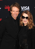 Producer Jerry Bruckheimer and wife Linda Bruckheimer arrive at 'The Lone Ranger' World Premiere at Disney's California Adventure on June 22 2013 in...