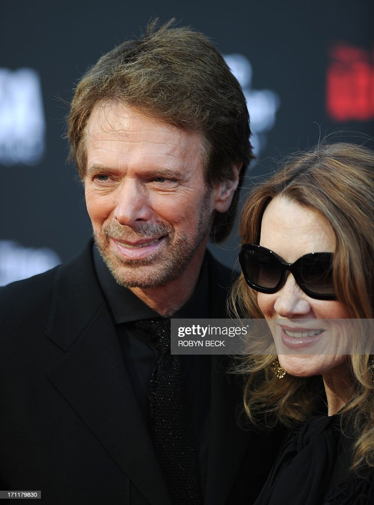 Producer Jerry Bruckheimer arrives with wife Linda for the world premiere of 'The Lone Ranger', at Disney California Adventure in Anaheim, California, June 22, 2013.