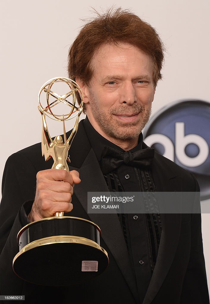 Producer Jerry Bruckheimer, winner of the Outstanding Reality-Competition Program award for 'The Amazing Race' poses in the press room at the 64th annual Prime Time Emmy Awards at the Nokia Theatre at LA Live in Los Angeles, California September 23, 2012.
