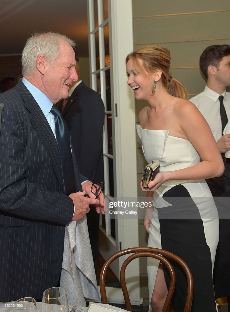 Producer Jerry Weintraub (L) and actress Jennifer Lawrence attend the Vanity Fair, Barneys New York and The Weinstein Company celebration of 'Silver Linings Playbook' in support of The Glenholme School on February 20, 2013 in Los Angeles, California