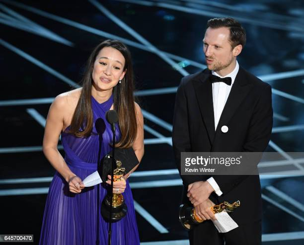 Producer Joanna Natasegara and director Orlando von Einsiedel accept Best Documentary Short Subject for 'The White Helmets' onstage during the 89th...