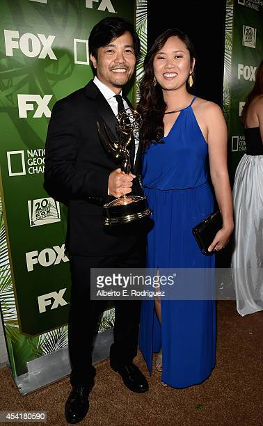 Producer Joel Kuwahara and guest attend the FOX 20th Century FOX Television FX Networks and National Geographic Channel's 2014 Emmy Award Nominee...