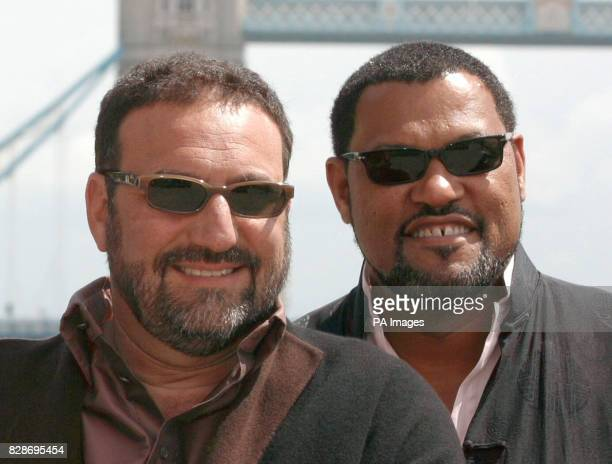 Producer Joel Silver and actor Laurence Fishburne pose for photographers during a photocall at Old Billingsgate Market in London ahead of the UK...