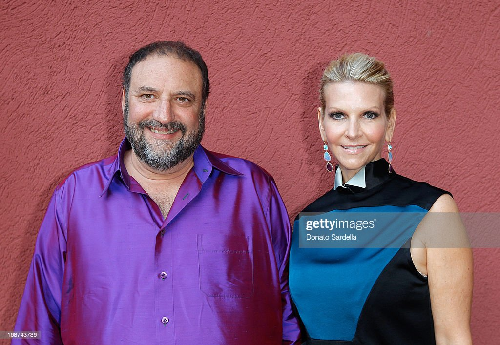 Producer <a gi-track='captionPersonalityLinkClicked' href=/galleries/search?phrase=Joel+Silver&family=editorial&specificpeople=216426 ng-click='$event.stopPropagation()'>Joel Silver</a> (L) and Karyn Silver attend a celebration of Jennifer Meyer's CFDA Swarovski nomination hosted by Rodarte at the residence of Joel and Karyn Silver on May 11, 2013 in Los Angeles, California.