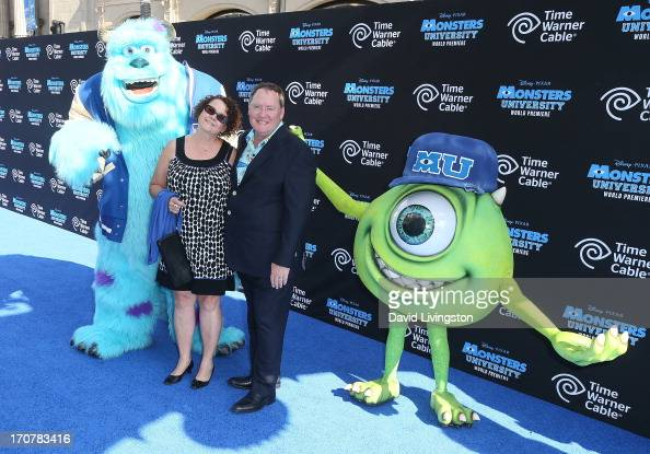 Producer John Lasseter and wife Nancy Lasseter pose with actors portraying 'Sulley' and 'Mike' at the premiere of Disney Pixar's 'Monsters...