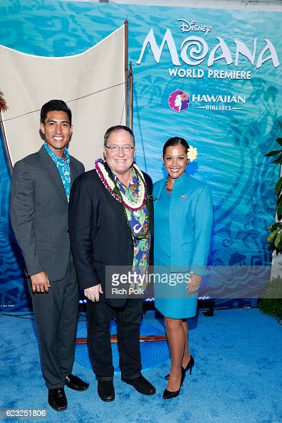 Producer John Lasseter is seen with the Hawaiian Airlines promo team at the Hawaiian Airlines booth at the world premiere of Disney's 'Moana' at the...