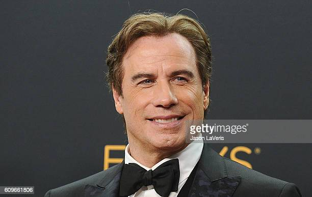 Producer John Travolta poses in the press room at the 68th annual Primetime Emmy Awards at Microsoft Theater on September 18 2016 in Los Angeles...